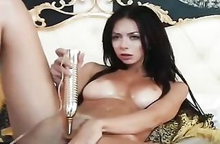 Sweet brunette babe vibrates her pussy