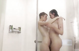 Classical lesbian couple plays in bathroom